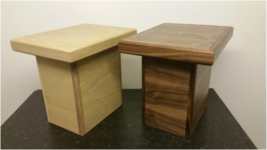 Oak and walnut side tables.